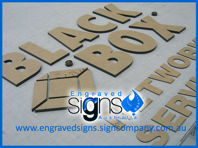 Cut out acrylic letters for signmaking. Black Box