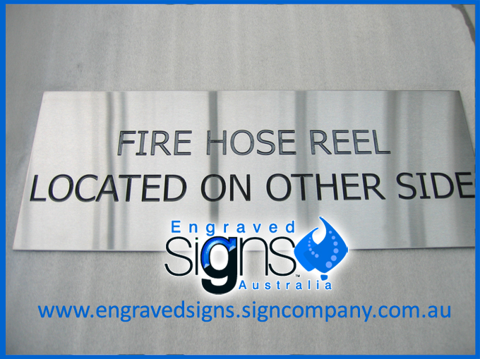 Sign. Fire Hose Reel Located On Other Side Sign