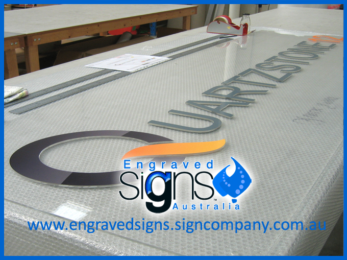 Raised plastic letters on clear sign panel also plastic