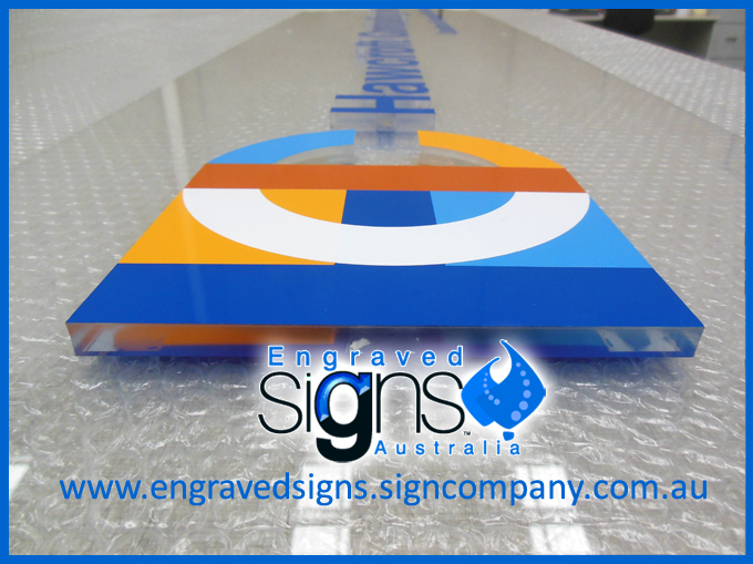 The sign makers photo of multi color logo sign with clear plastic letters and color face of blue, orange and terracotta. This is a beautiful sign